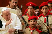 Pope John Paul II's blesses a music band from Palestine as he presides over his weekly general audience in the courtyard of his summer residence in...