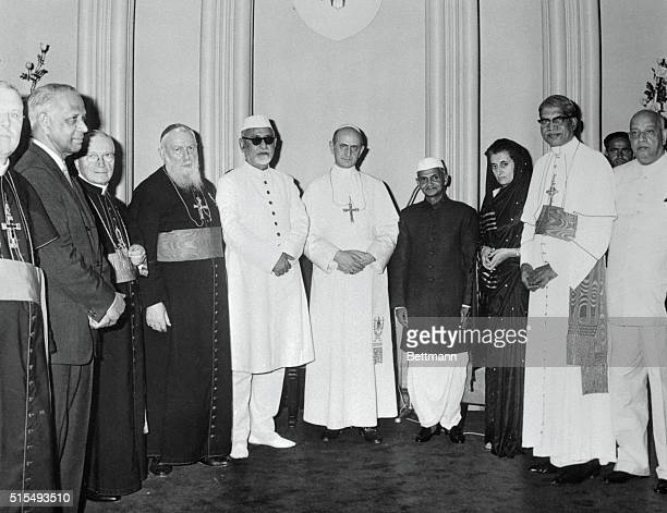 Pope Paul VI attending the Eucharistic Congress in Bombay meets with church leaders and officials of the Indian government Cardinal Tisserant Indian...