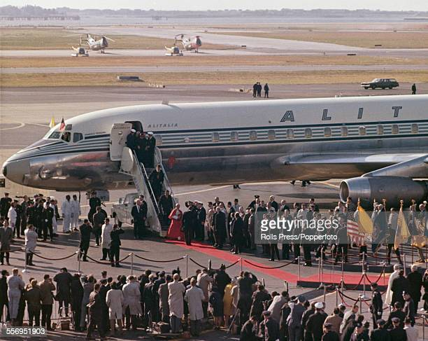 Pope Paul VI leaves his Alitalia aircraft at John F Kennedy International Airport in New York to meet dignitaries on a red carpet at the start of a...