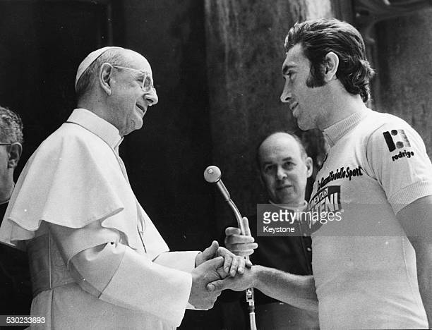 Pope Paul VI shaking the hand of champion cyclist Eddy Merckx prior to the start of the Tour of Italy race Vatican City Rome May 16th 1974