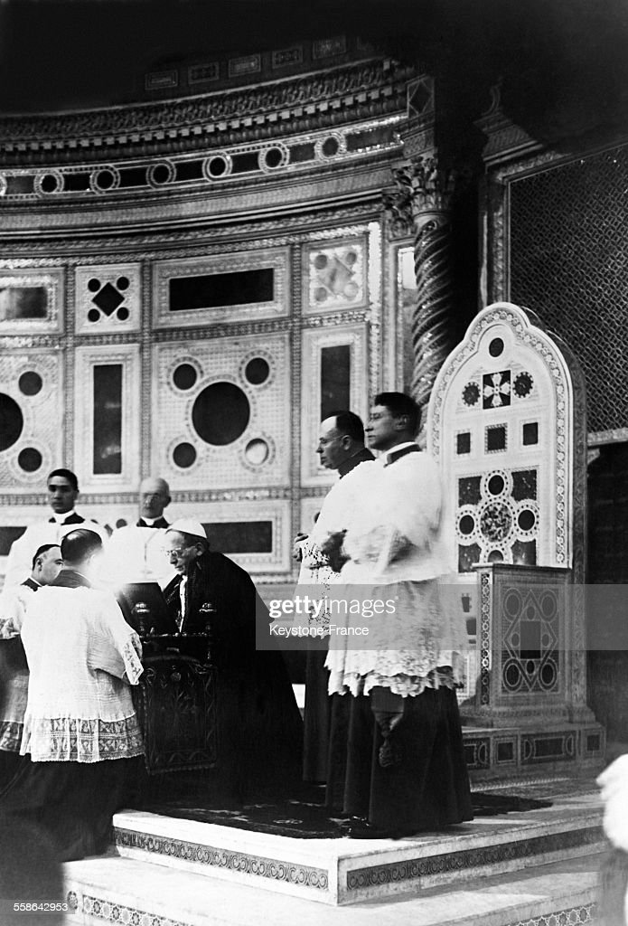 <a gi-track='captionPersonalityLinkClicked' href=/galleries/search?phrase=Pope+Pius+XI&family=editorial&specificpeople=93954 ng-click='$event.stopPropagation()'>Pope Pius XI</a> celebrating mass in the Basilica of Saint John Lateran, on December 23, 1929 in Rome, Italy.