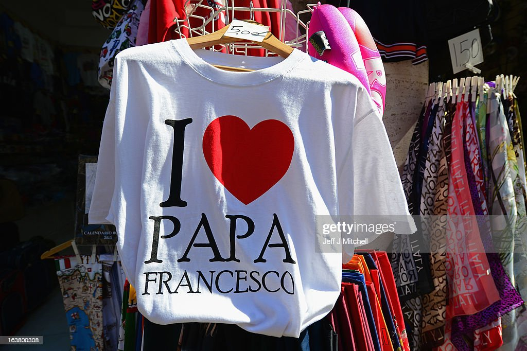 A pope tee shirt for sale in a merchandise shop on March 16, 2013 in Rome, Italy.Rome is preparing for the inauguration mass of Pope Francis on March 19th.