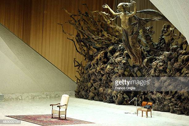 Pope's throne is seen at the Paul VI Hall during the Pope Francis weekly audience on August 5 2015 in Vatican City Vatican In his catechesis Pope...
