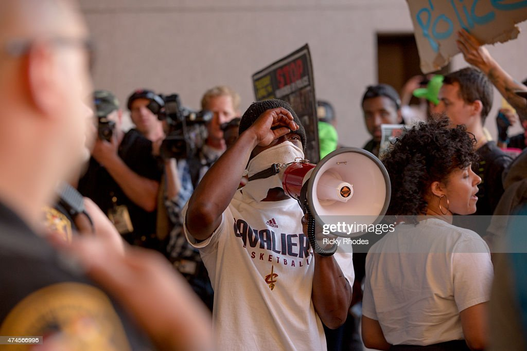 Pople protest outside the Justice Center in reaction to Cleveland police officer Michael Brelo being acquitted of manslaughter charges after he shot...