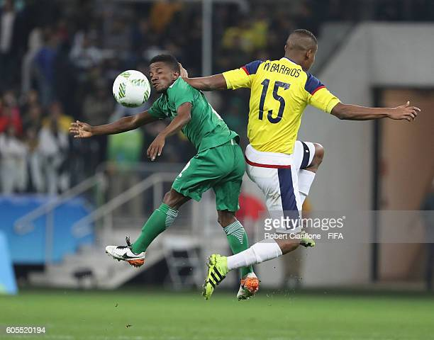 Popoola Saliu of Nigeria and Wilmar Barrios of Colombia compete for the ball during the Men's First Round Group B match between Colombia and Nigeria...