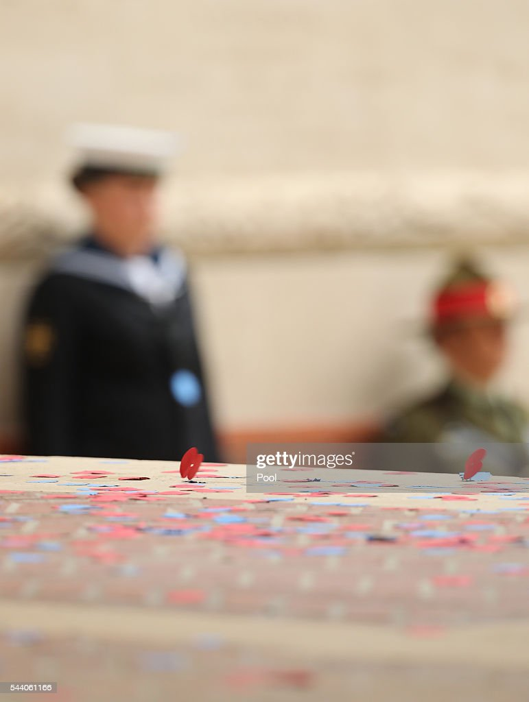 Poppies are dropped at a service to mark the 100th anniversary of the beginning of the Battle of the Somme at the Thiepval memorial to the Missing on July 1, 2016 in Thiepval, France. The event is part of the Commemoration of the Centenary of the Battle of the Somme at the Commonwealth War Graves Commission Thiepval Memorial in Thiepval, France, where 70,000 British and Commonwealth soldiers with no known grave are commemorated.