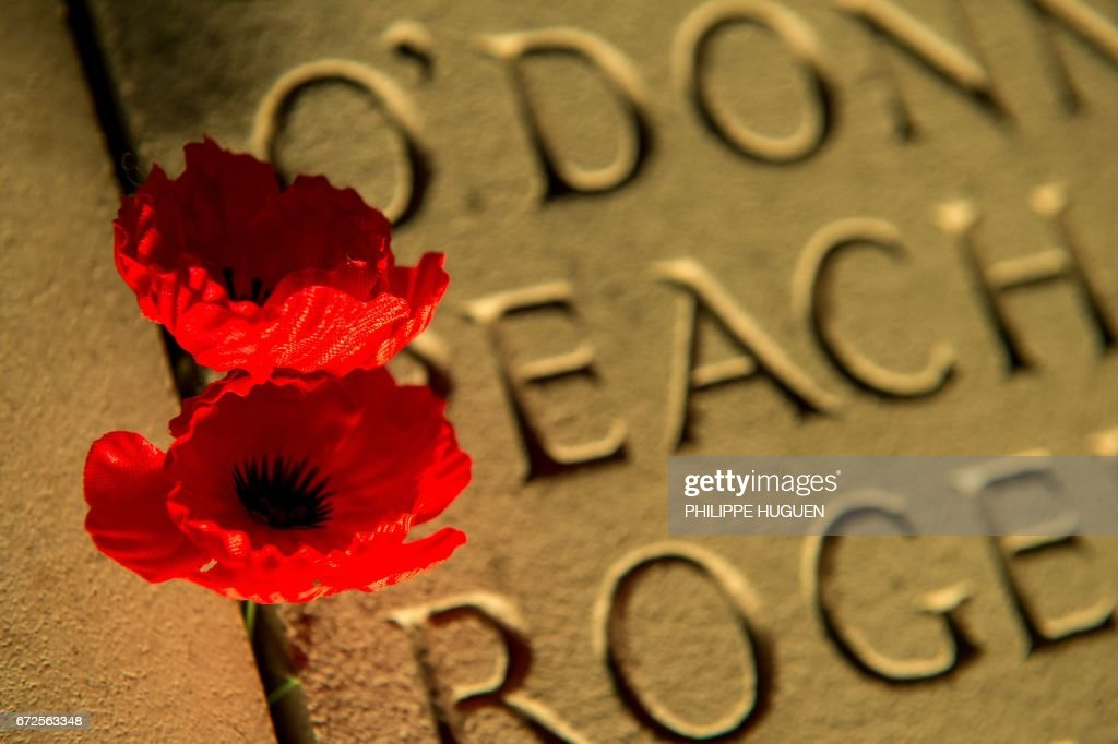 TOPSHOT - Poppies are pegged on the wall bearing the WWI dead soldiers' names at the military cemetery of the Australian National Memorial in Villers-Bretonneux, northern France, on April 25, 2017, during Anzac Day marking 101 years since Australian and NZ Army Corps soldiers landed in Gallipoli during WWI, and were deployed to the Western Front, where they played an important role in the 1916 Battle of the Somme. The memorial in Villers-Bretonneux lists 10,773 names of soldiers of the Australian Imperial Force with no known grave who were killed between 1916, when Australian forces arrived in France and Belgium, and the end of the war. /