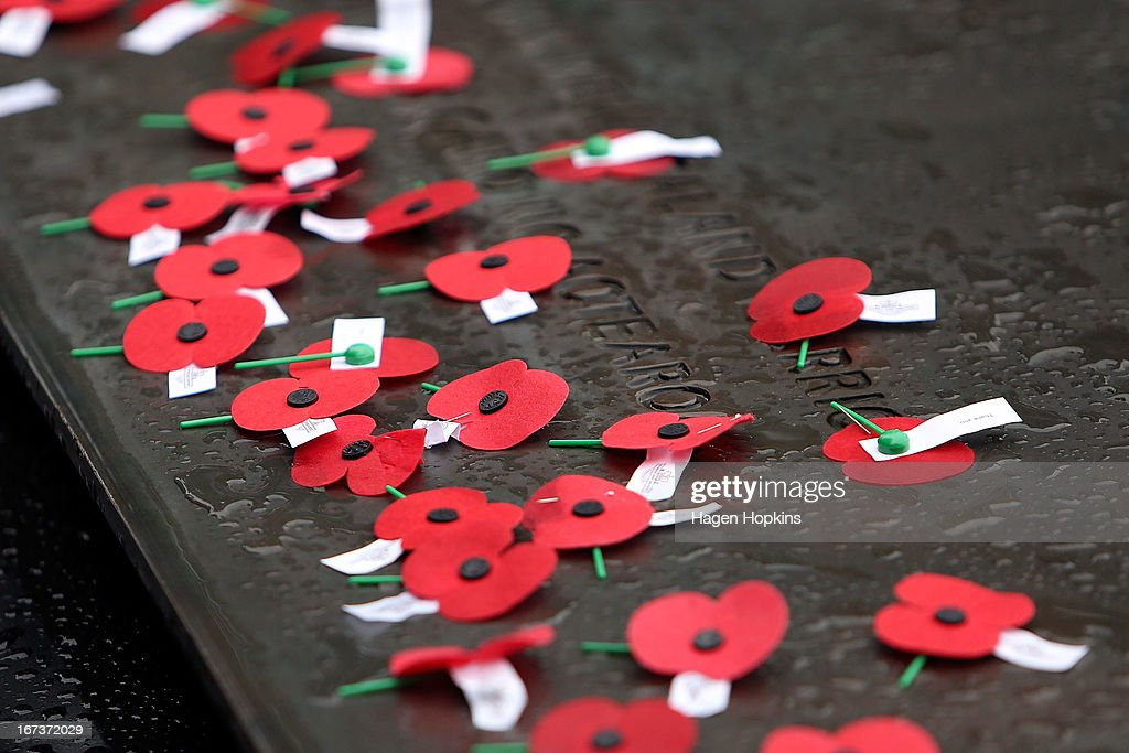Poppies lay on the Tomb of the Unknown Warrior during the National Commemorative Service at the National War Memorial on April 25, 2013 in Wellington, New Zealand. Veterans, dignitaries and members of the public today marked the 98th anniversary of ANZAC (Australia New Zealand Army Corps) Day, April 25, 1915 when allied New Zealand and Australian First World War forces landed on the Gallipoli Peninsula. Commemoration events are held across both countries in remembrance of those who fought and died in all wars.