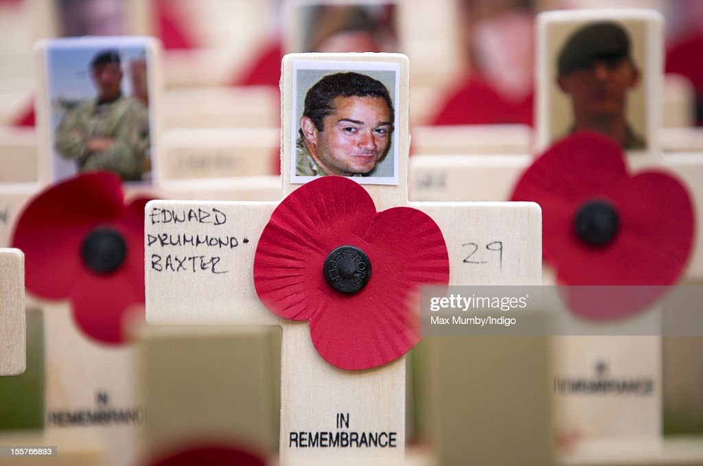 A Poppy and cross in memory of soldier Lt Edward Drummond-Baxter, the latest member of the British Armed Forces to be killed in action whilst serving in Afghanistan, placed in The Field of Remembrance at Westminster Abbey on November 08, 2012 in London, England.