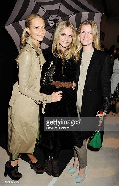 Poppy Cara and Chloe Delevingne pose backstage following the Burberry Autumn Winter 2012 Womenswear Show during London Fashion Week at Kensington...