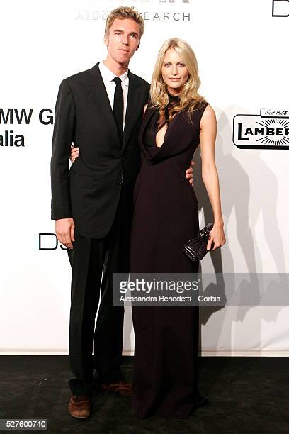Poppy Delevigne and guest on the AmfAR Milano 2009 red carpet during the inaugural Milan Fashion Week event at La Permanente