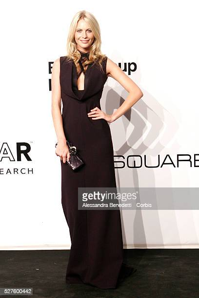 Poppy Delevigne on the AmfAR Milano 2009 red carpet during the inaugural Milan Fashion Week event at La Permanente