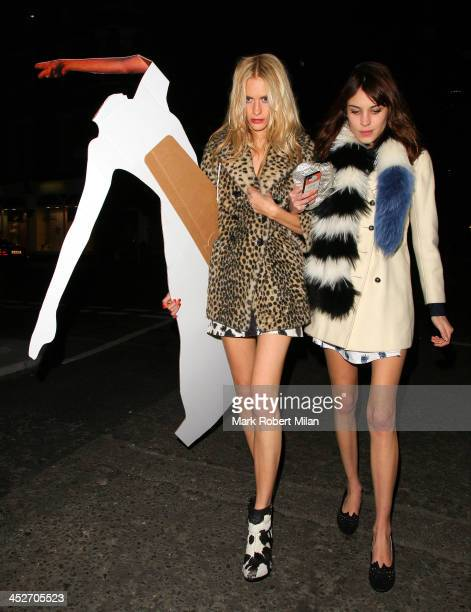 Poppy Delevingne and Alexa Chung arrive at the Edition Hotel to celebrate Poppy Delevingne's Hen party on November 30 2013 in London England