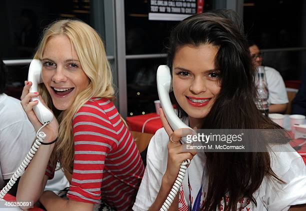 Poppy Delevingne and Bip Ling attend a fundraising telethon to raise money for the DEC Philippines Typhoon Appeal on November 18 2013 in London...