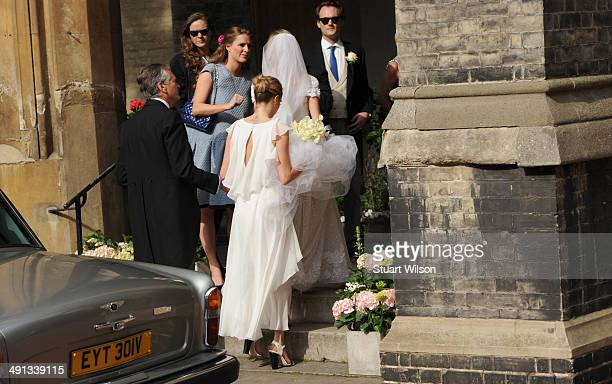 Poppy Delevingne and Cara Delevingne arrive for Poppy's wedding at St Pauls Knightsbridge on May 16 2014 in London England