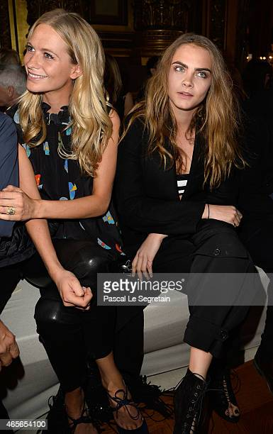 Poppy Delevingne and Cara Delevingne attend the Stella McCartney show as part of the Paris Fashion Week Womenswear Fall/Winter 2015/2016 on March 9...