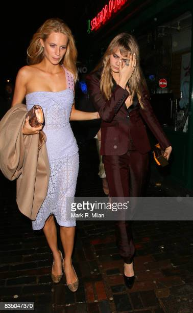 Poppy Delevingne and Cara Delevingne depart the Box night club on February 14 2014 in London England
