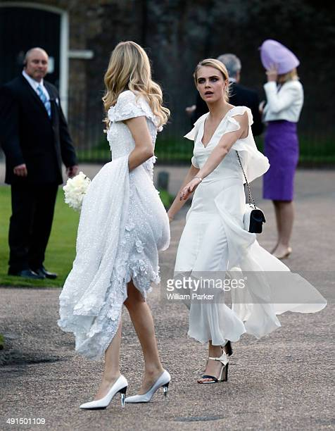 Poppy Delevingne and Cara Delevingne seen at Poppy Delevingnes wedding held in Kensington Palace Gardens on May 16 2014 in London England