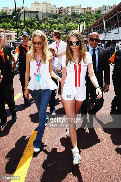 Poppy Delevingne and Cara Delevingne walk down the pitlane before the start of the Monaco Formula One Grand Prix at Circuit de Monaco on May 24 2015...