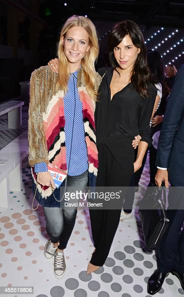 Poppy Delevingne and Caroline Sieber attend the Anya Hindmarch SS15 Presentation during London Fashion Week at Ambika P3 Gallery on September 16 2014...