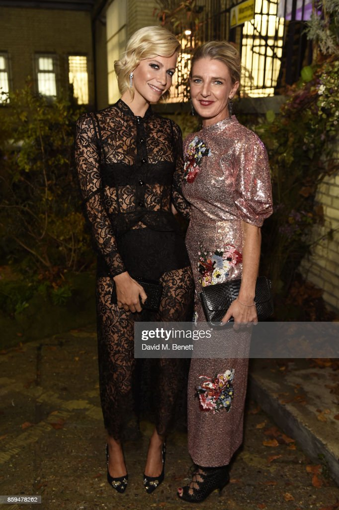 Poppy Delevingne (L) and Melinda Stevens attend the Conde Nast Traveller 20th anniversary after party at Annabel's on October 9, 2017 in London, England.