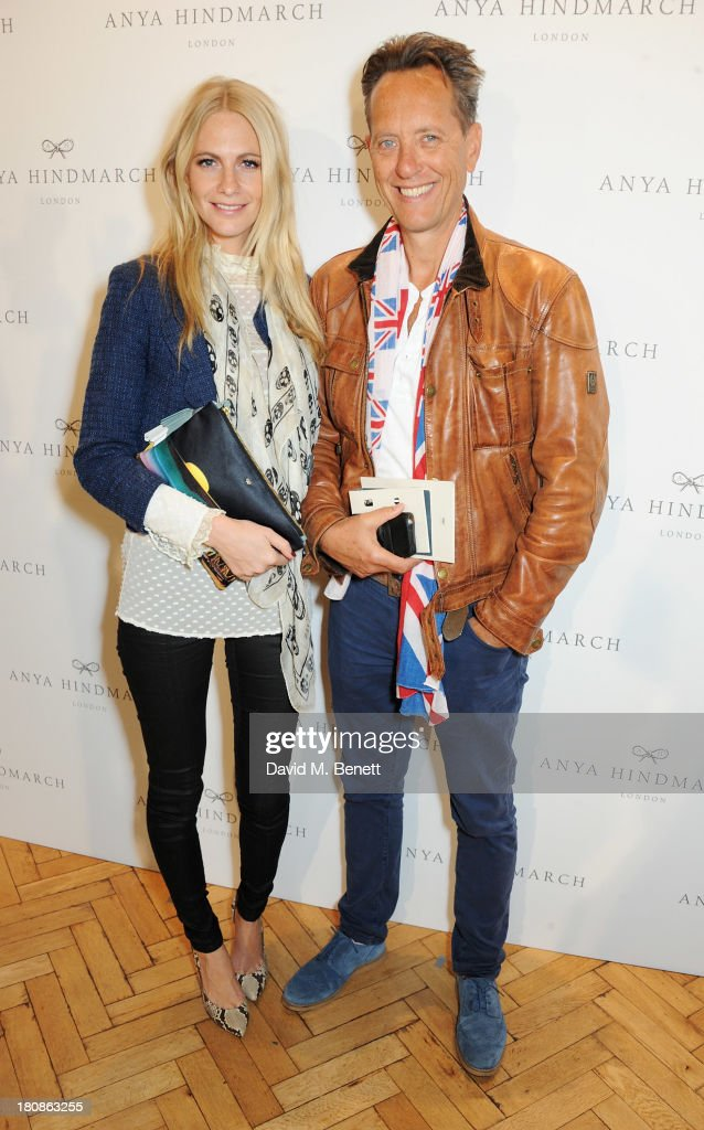 Poppy Delevingne (L) and Richard E. Grant attend the Anya Hindmarch presentation during London Fashion Week SS14 at Central Hall Westminster on September 17, 2013 in London, England.