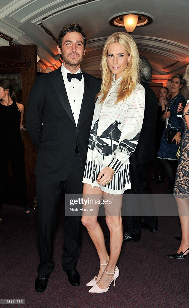 <a gi-track='captionPersonalityLinkClicked' href=/galleries/search?phrase=Poppy+Delevingne&family=editorial&specificpeople=2348985 ng-click='$event.stopPropagation()'>Poppy Delevingne</a> and Robert Konjic attend the British Fashion Awards 2013 at London Coliseum on December 2, 2013 in London, England.