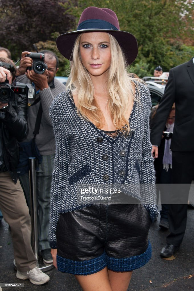 Poppy Delevingne arrives at the Chanel Spring / Summer 2013 show as part of Paris Fashion Week at Grand Palais on October 2, 2012 in Paris, France.