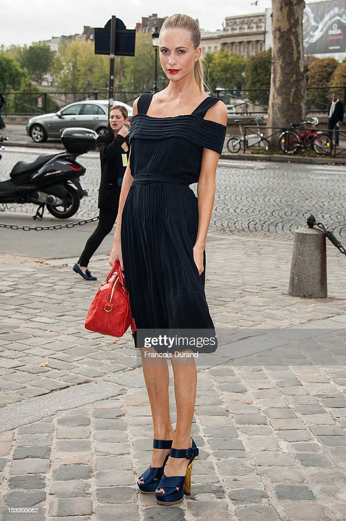 Poppy Delevingne arrives at the Louis Vuitton Spring/Summer 2013 show as part of Paris Fashion Week on October 3, 2012 in Paris, France.