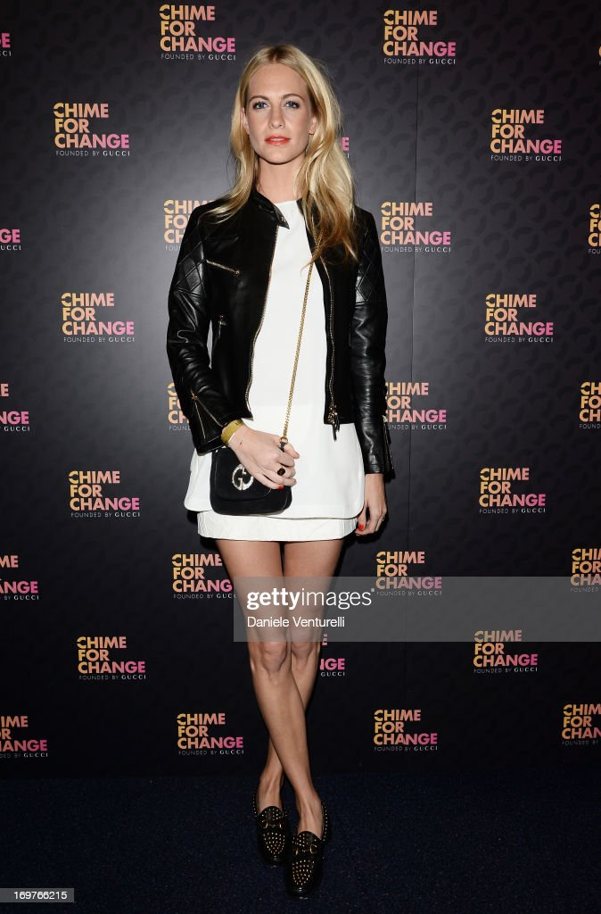 <a gi-track='captionPersonalityLinkClicked' href=/galleries/search?phrase=Poppy+Delevingne&family=editorial&specificpeople=2348985 ng-click='$event.stopPropagation()'>Poppy Delevingne</a> arrives at the Royal Box photo wall ahead of the 'Chime For Change: The Sound Of Change Live' Concert at Twickenham Stadium on June 1, 2013 in London, England. Chime For Change is a global campaign for girls' and women's empowerment founded by Gucci with a founding committee comprised of Gucci Creative Director Frida Giannini, Salma Hayek Pinault and Beyonce Knowles-Carter.