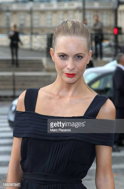 Poppy Delevingne arrives to attend the Louis Vuitton Spring/Summer 2013 show as part of Paris Fashion Week on October 3 2012 in Paris France