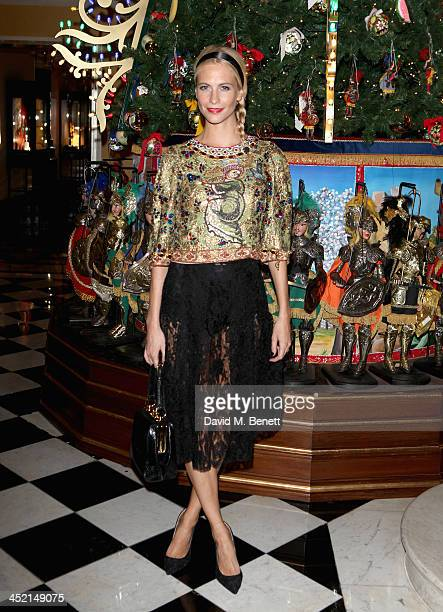Poppy Delevingne attends Claridge's Christmas Tree By Dolce Gabbana launch party at Claridge's Hotel on November 26 2013 in London England