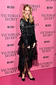 Poppy Delevingne attends the annual Victoria's Secret fashion show at Earls Court on December 2 2014 in London England