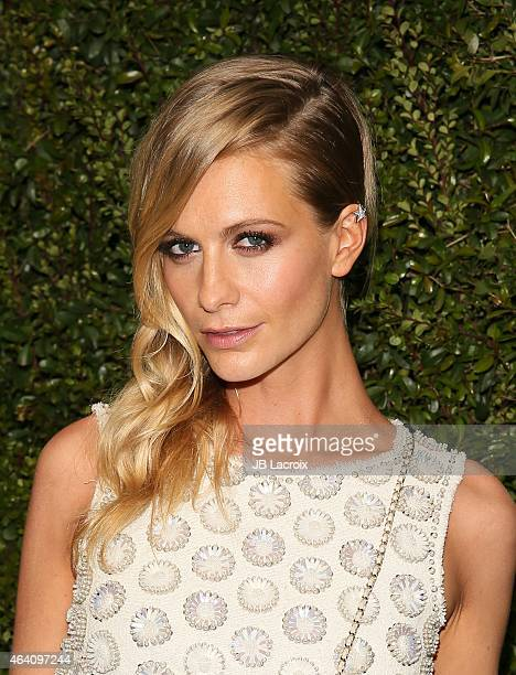 Poppy Delevingne attends the Chanel And Charles Finch PreOscar Dinner at Madeo Restaurant on February 21 2015 in West Hollywood California