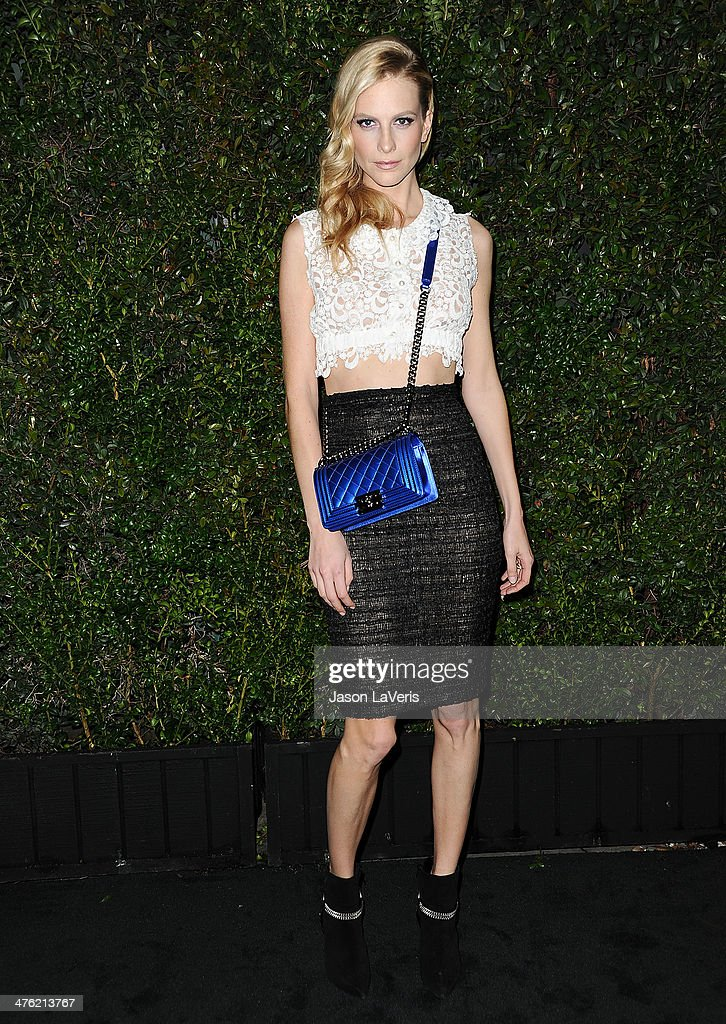 Poppy Delevingne attends the Chanel and Charles Finch pre-Oscar dinner at Madeo Restaurant on March 1, 2014 in Los Angeles, California.