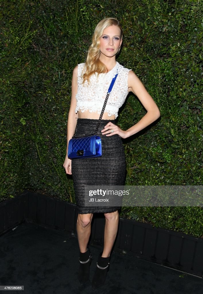Poppy Delevingne attends the Chanel Charles Finch Pre-Oscar Dinner held at Madeo Restaurant on March 1, 2014 in Los Angeles, California.