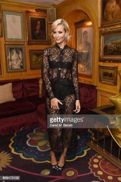 Poppy Delevingne attends the Conde Nast Traveller 20th anniversary after party at Annabel's on October 9 2017 in London England