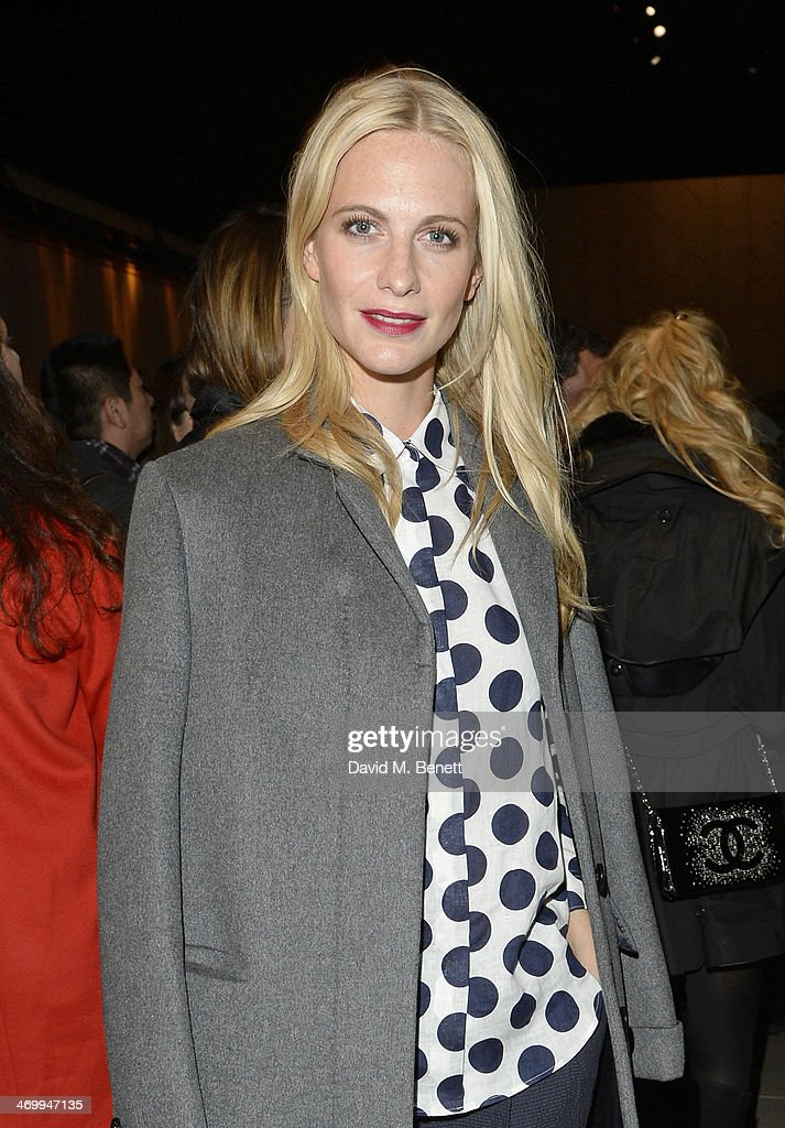 <a gi-track='captionPersonalityLinkClicked' href=/galleries/search?phrase=Poppy+Delevingne&family=editorial&specificpeople=2348985 ng-click='$event.stopPropagation()'>Poppy Delevingne</a> attends the front row at Burberry Womenswear Autumn/Winter 2014 at Kensington Gardens on February 17, 2014 in London, England.