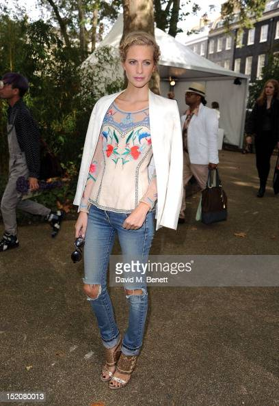 Poppy Delevingne attends the front row for the Unique show on day 3 of London Fashion Week Spring/Summer 2013 at TopShop Venue on September 16 2012...