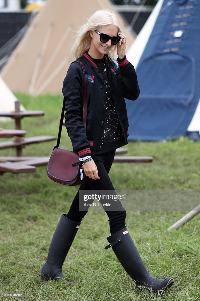 Poppy Delevingne wearing Coach attends the Glastonbury Festival at Worthy Farm, Pilton on June 25, 2016 in Glastonbury, England.