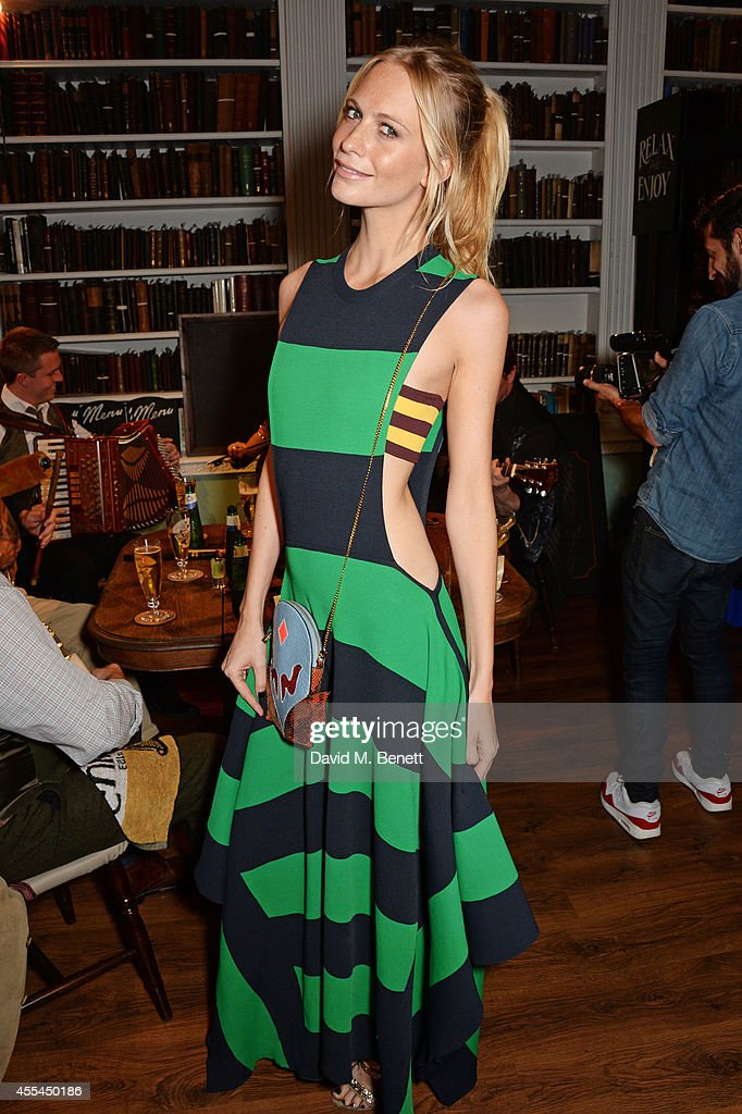 Poppy Delevingne attends The London 2014 Stella McCartney Green Carpet Collection during London Fashion Week at The Royal British Institute on...