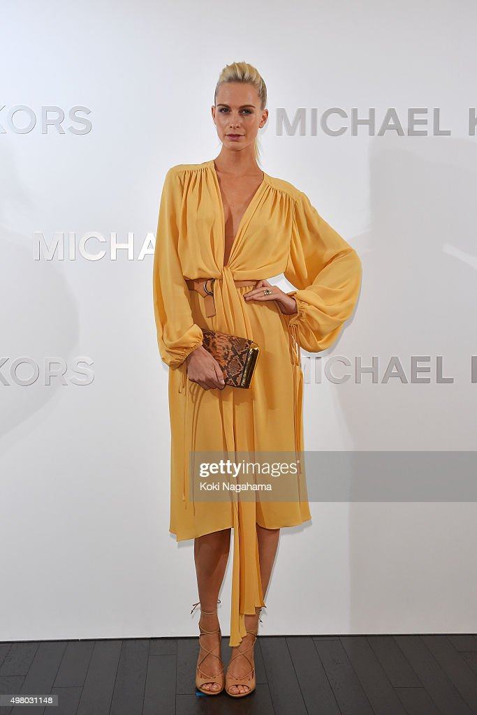 Poppy Delevingne attends the opening event for the Michael Kors Ginza Flagship Store on November 20, 2015 in Tokyo, Japan.