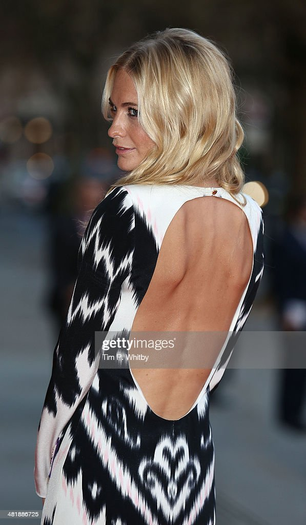 Poppy Delevingne attends the preview of The Glamour of Italian Fashion exhibition at Victoria & Albert Museum on April 1, 2014 in London, England.