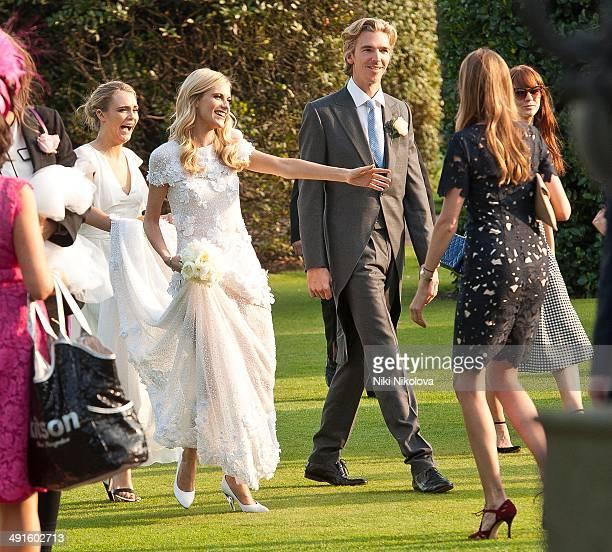 Poppy Delevingne Cara Delevingne and James Cook are seen at Poppy Delevingnes and James Cook's wedding reception held in Kensington Palace Gardens on...
