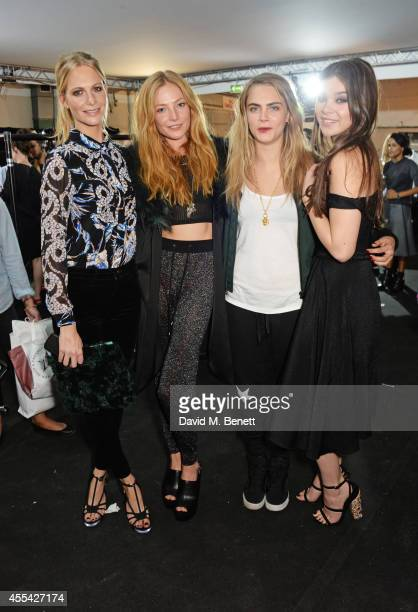 Poppy Delevingne Clara Paget Cara Delevingne and Hailee Steinfeld attend the Topshop Unique SS15 Front Row on September 14 2014 in London England