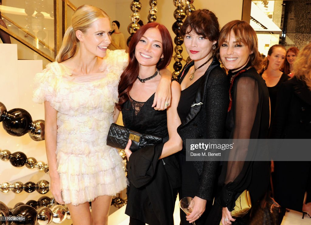(L to R) Poppy Delevingne, Clara Paget, Jasmine Guinness and Yasmin Le Bon attend a private view of the new CHANEL flagship boutique on New Bond Street on June 10, 2013 in London, England.