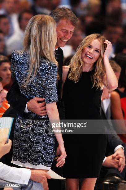 Poppy Delevingne HUGO BOSS CEO ClausDietrich Lahrs and Kate Bosworth during the Hugo By Hugo Boss Show at the MercedesBenz Fashion Week Spring/Summer...