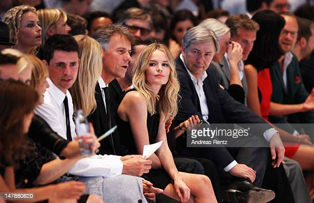 Poppy Delevingne HUGO BOSS CEO ClausDietrich Lahrs Kate Bosworth and Berlin mayor Klaus Wowereit sit in front row during the Hugo By Hugo Boss Show...