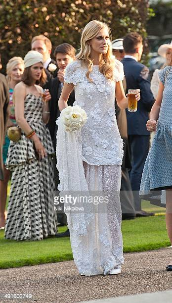 Poppy Delevingne is seen at Poppy Delevingne and James Cook's wedding reception held in Kensington Palace Gardens on May 16 2014 in London England