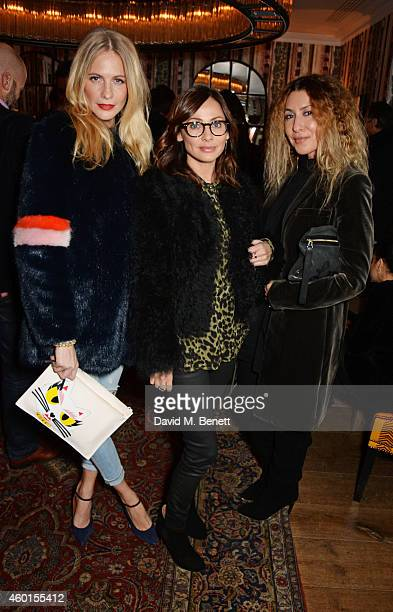 Poppy Delevingne Natalie Imbruglia and guest attend a VIP screening of 'St Vincent' hosted by Poppy Delevingne at The Covent Garden Hotel on December...